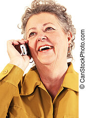 Senior woman on the cell phone. - A senior woman in an dark...