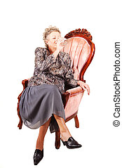 Senior woman in pink armchair. - All dressed up elderly...