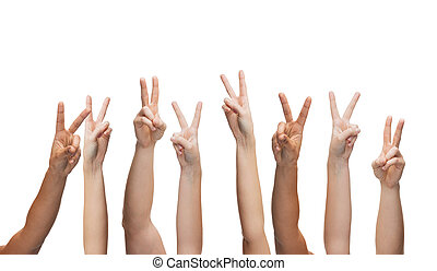 human hands showing v-sign - gesture and body parts concept...