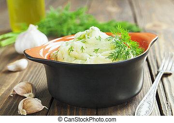 Potato puree with dill in the ceramic pot