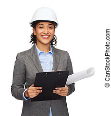 businesswoman in white helmet with clipboard - building,...