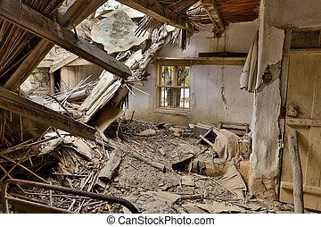 Derelict house with collapsed roof - Collapsed roof in an...