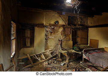 Derelict bedroom in an abandoned house in an old village in...