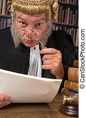 Judge with lorgnette - Funny old judge looking through a...