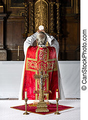 Consecration the old way - Priest during consecration the...
