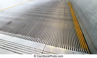 Escalators are shown that constantly run upstairs