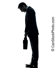 sad business man  looking down silhouette