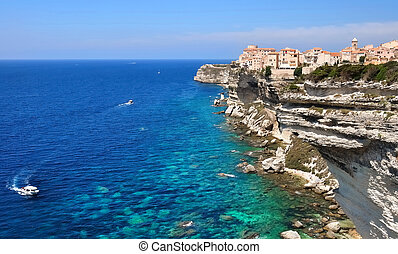 Village Bonifacio in Corsica - village perched on a cliff at...
