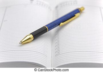 open calendar with pen
