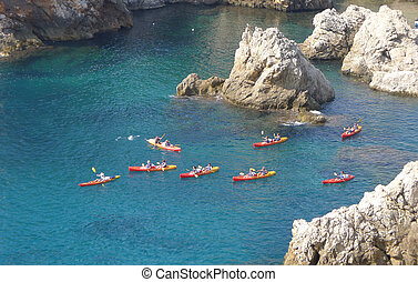 People Canoeing in the sea near Dubrovnik, Croatia, Europe