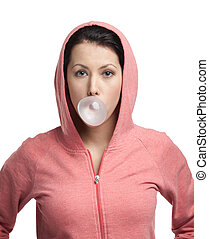Woman blows out pink bubble gum - Lady in sweatshirt blows...
