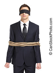 Blind-folded businessman tied with the cord - Portrait of...