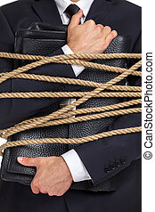 Close up of man handing briefcase tied with the rope - Close...