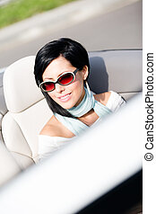 Close up of woman in the convertible car