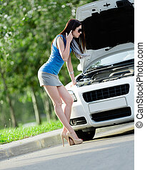 Woman repairing the broken cabriolet - Woman opens car...