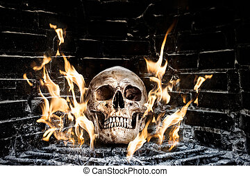 Human skull in stove - Still life with human skull on fire n...