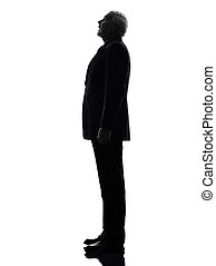 senior business man surprised looking up silhouette