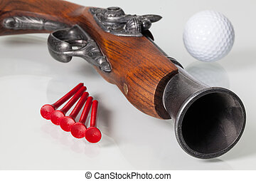 Old gun and golf equipments - Very old gun and golf...