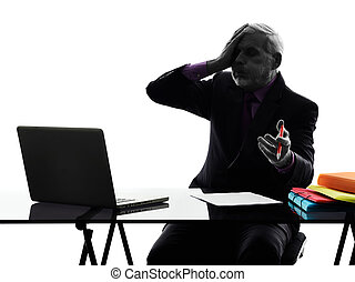 senior business man computing displeased silhouette - One...