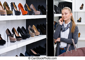 Woman looking at the rows of footwear