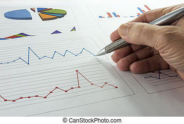 data graphics analysis - hand with pen making grafics and...