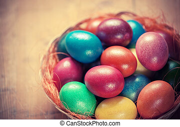 Easter eggs in the basket - colorful Easter eggs in the...