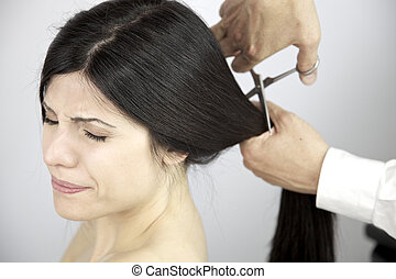 Scary moment long hair being cut by hairdresser