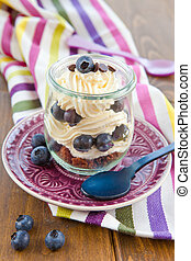 Layered dessert with fresh blueberries - Layered cream...
