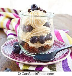 Layered dessert with fresh blueberries - Layered cream...