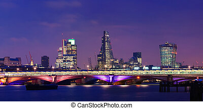 London at night - Blackfriars Bridge with London urban...