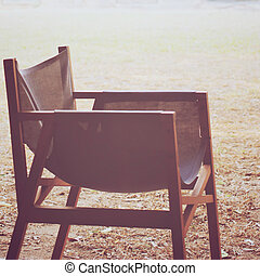 Modern wood chair in the garden with retro filter effect