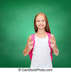 smiling teenage girl in blank white tank top - education and...