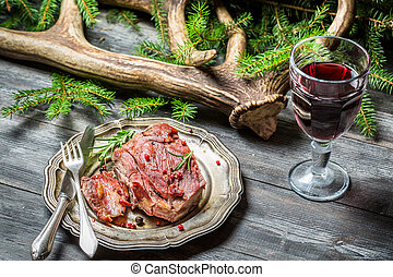 Venison served in the forester lodge with wine