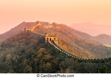 Great Wall sunset over mountains in Beijing, China