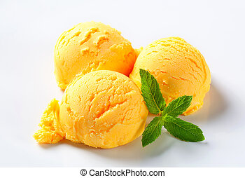Scoops of mango sorbet - Scoops of yellow ice cream on a...