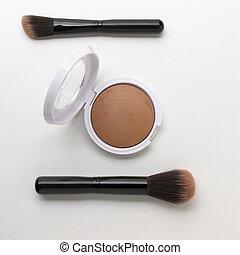 Face powder kit isolated on white background