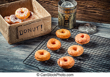 Preparing to decorate donuts with icing sugar