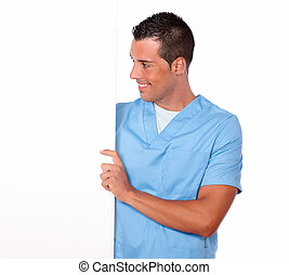 Male nurse holding and looking at white placard - Portrait...