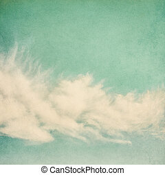 Vintage Puffy Clouds - Ethereal and puffy clouds on a...