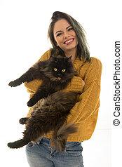 Beautiful woman carrying her cat