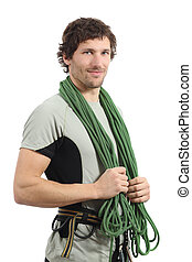 Attractive rock climber posing with harness and cord...