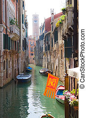 Venice - Beautiful canal and traditional venetian flag,...