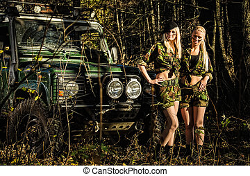Girls and off-road vehicle - Beautiful girls on camouflage...