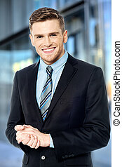 Smiling businessman posing confidently - Corporate guy...