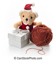 Santa bear - Small bear in Santa claus suit sit near silver...