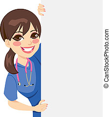 Young Nurse Peeking - Cute happy young professional nurse...