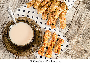 Garlic cheese bread sticks and cup of black tea with milk...