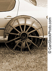 old wagon wheel addition on new cars - old broken wagon...