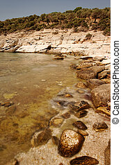 rocky beach at greece , thassos - rocky beach with turquoise...