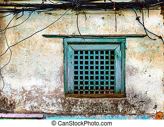 Old green window and grungy wall in Kathmandu, Nepal